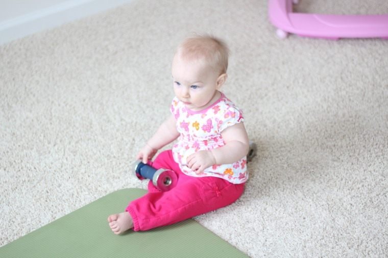 Like my workout buddy? She loves to play with the weights-she's a little beast!